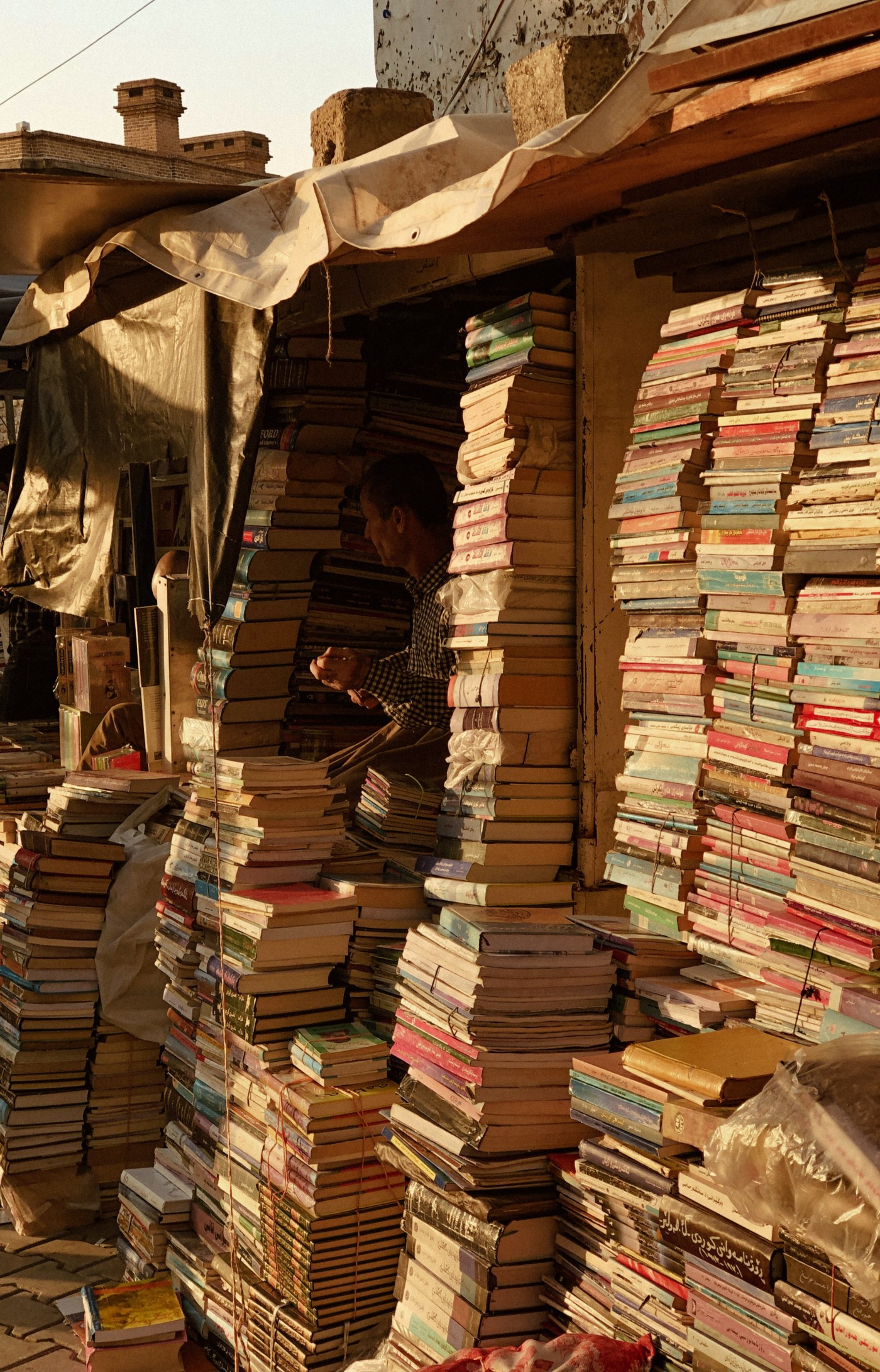 Books stacked high in modern-day Iraq