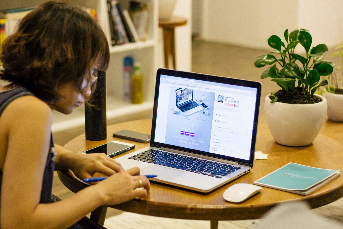 Woman typing on a a laptop.