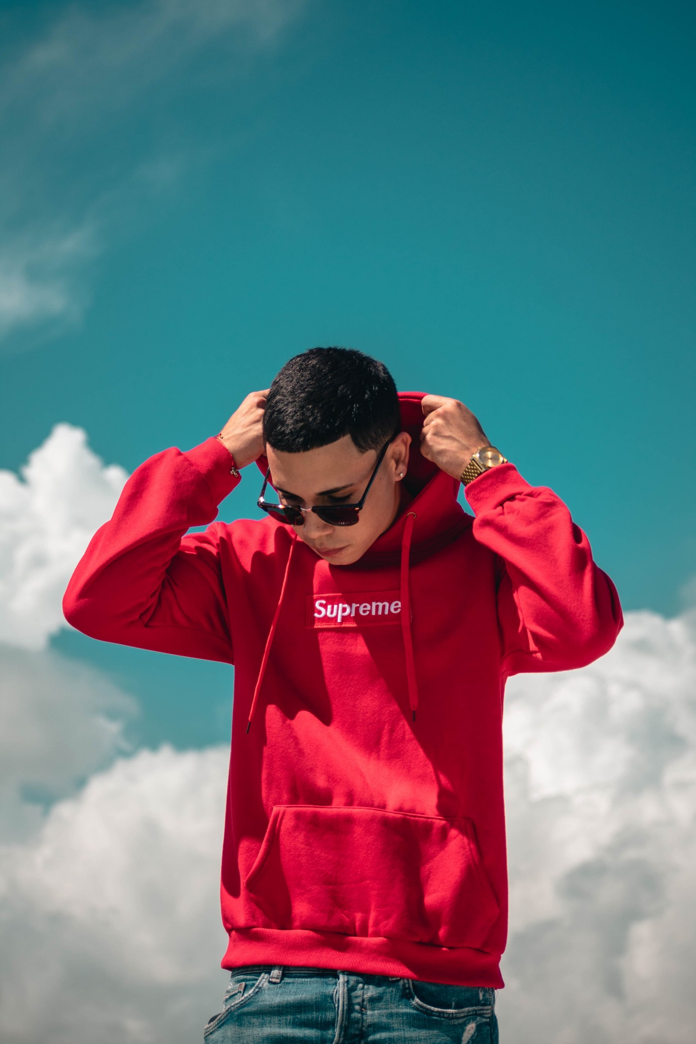 A man in a red hoodie.