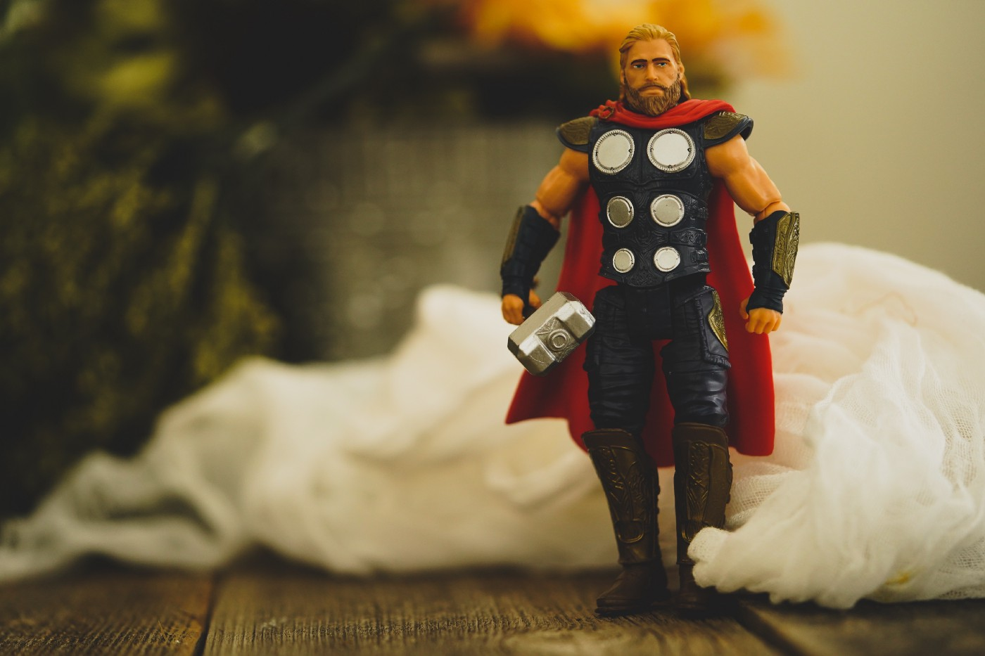 Thor action figure with hammer and cape