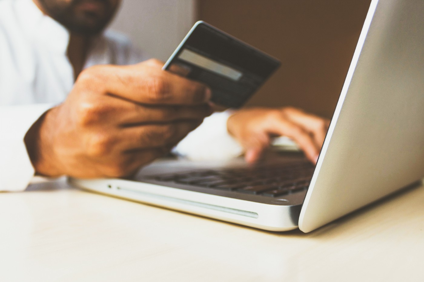 A person entering their credit card details for an online sale