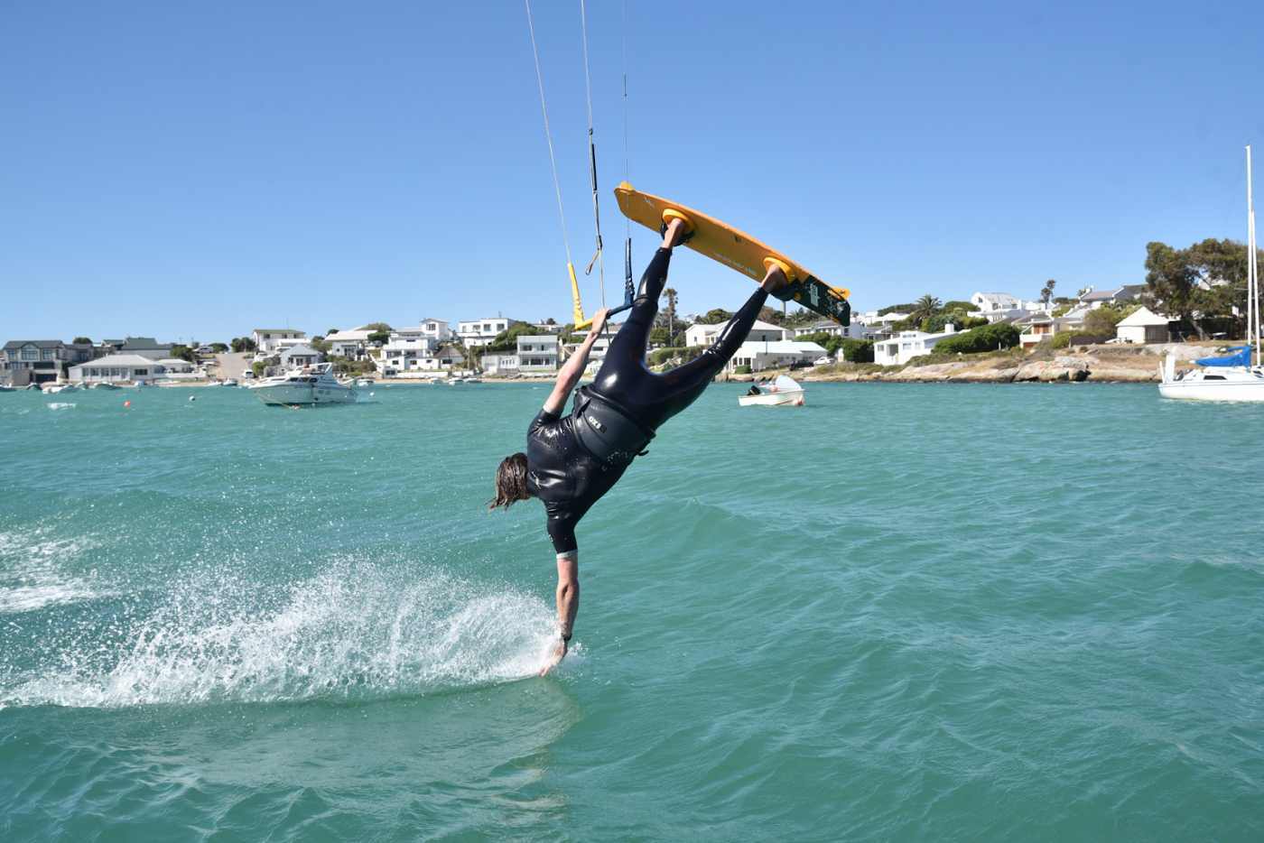 Matt Maxwell performing tricks with his kiteboard in the sea