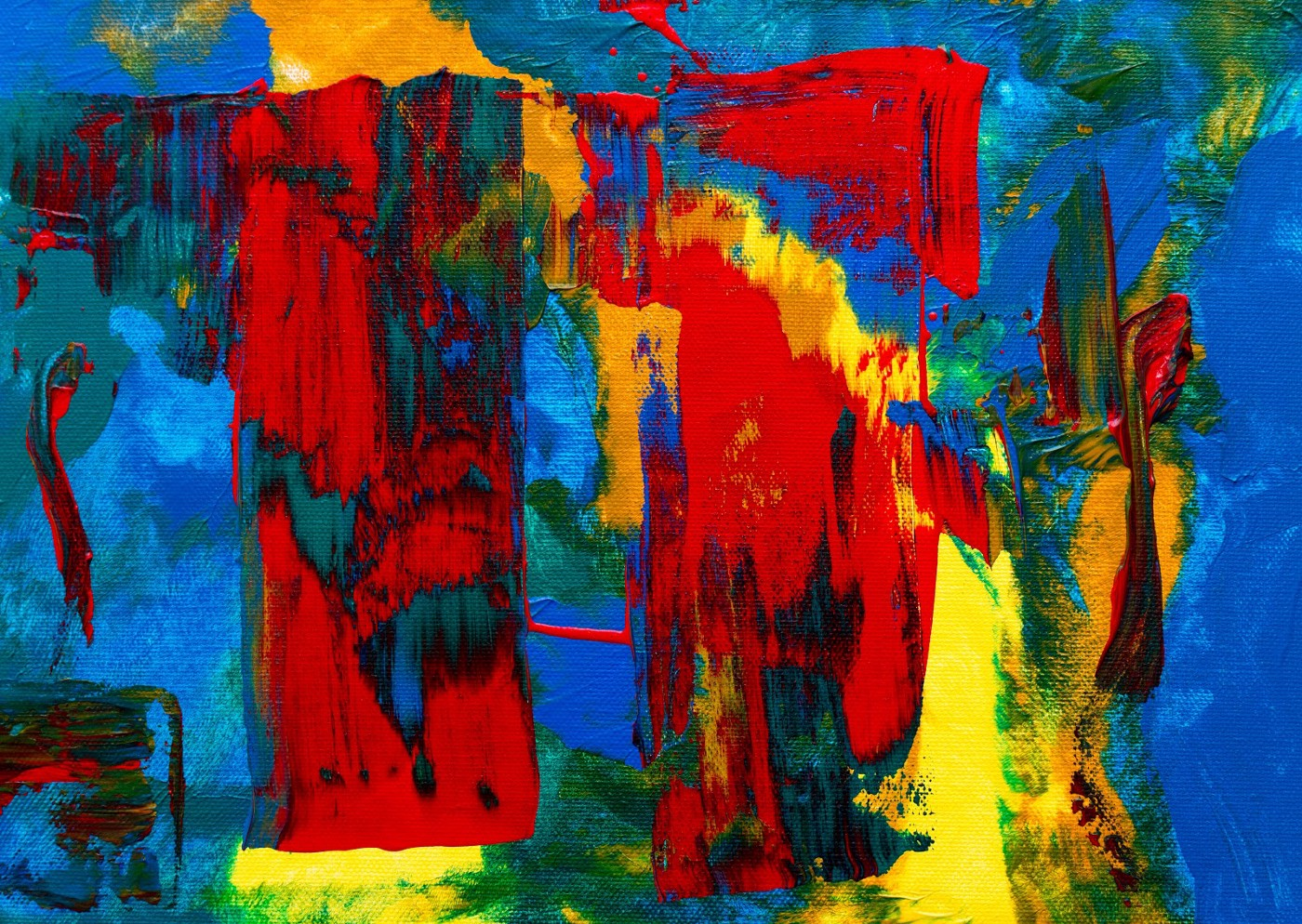 An abstract painting of red, blue, green, and yellow.
