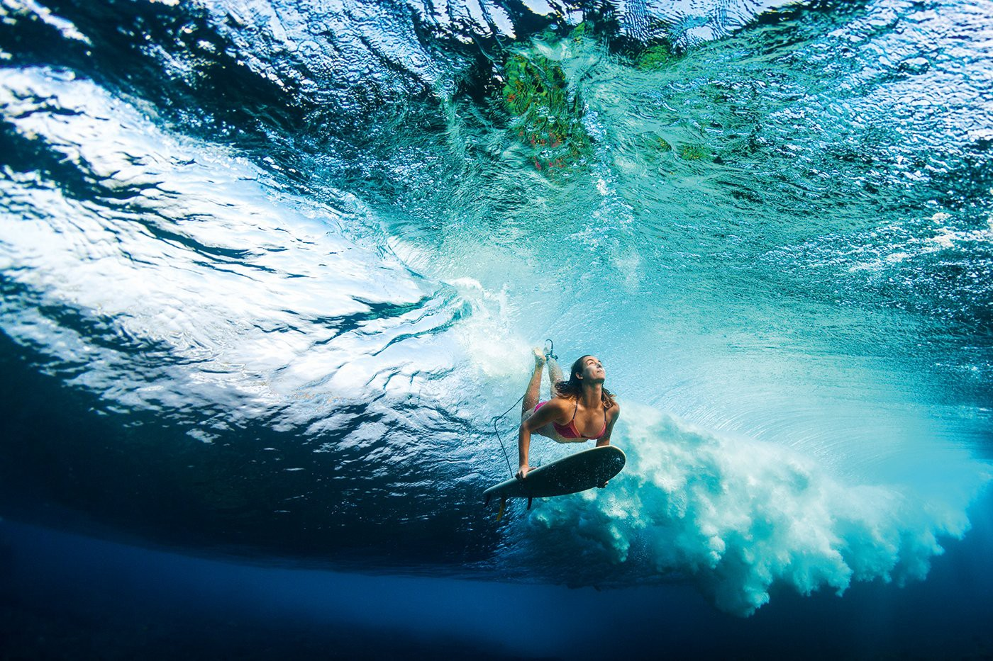 Surfer Anna Ehrgott captured with her board below a wave forming. (Photo: Sarah Lee, She Surf)