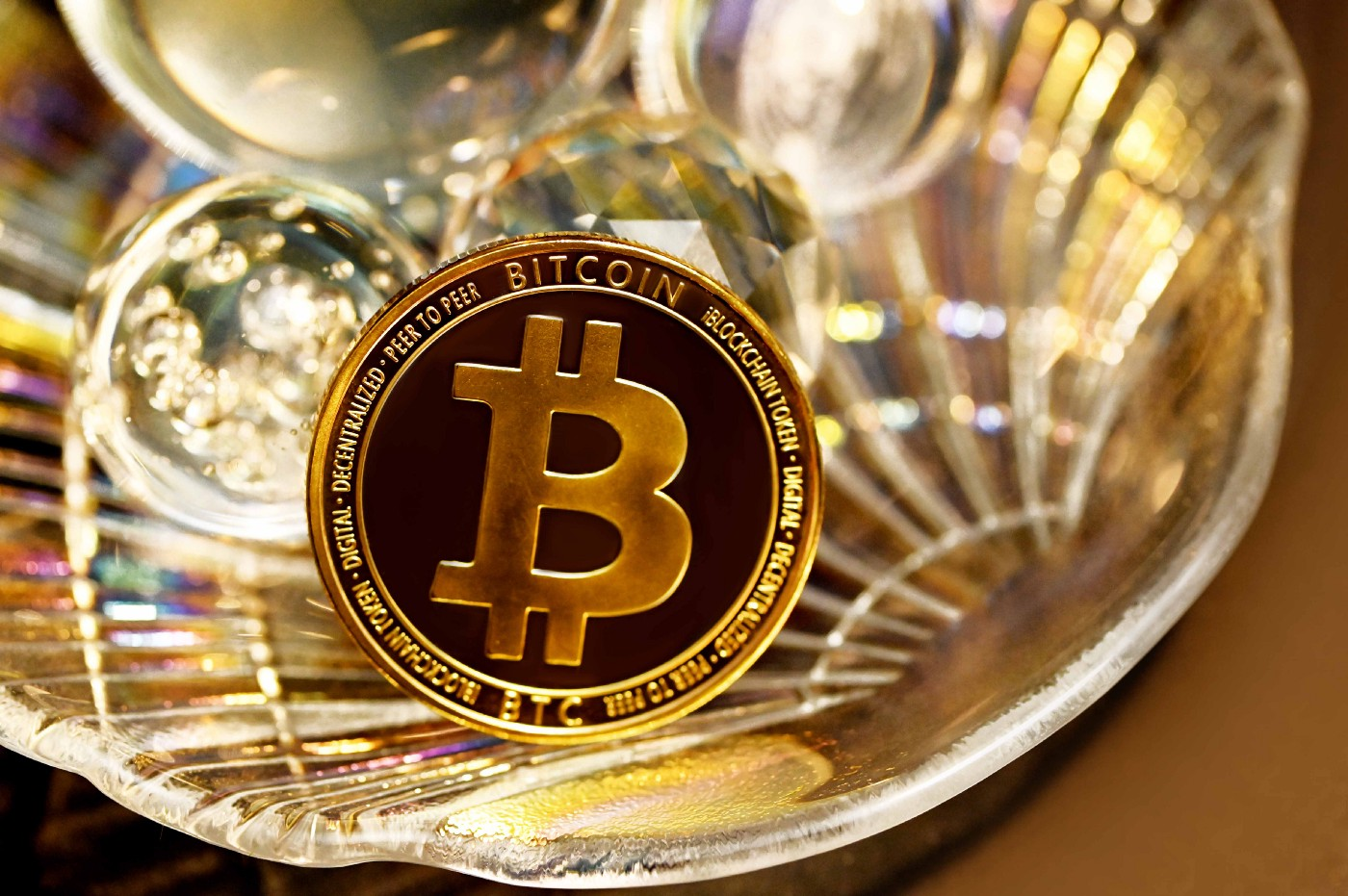An image of a Bitcoin cryptocurrency 'coin' in a gold dish. I Bought $100 Of Bitcoin On A Whim | Shannon Cheesman | Medium