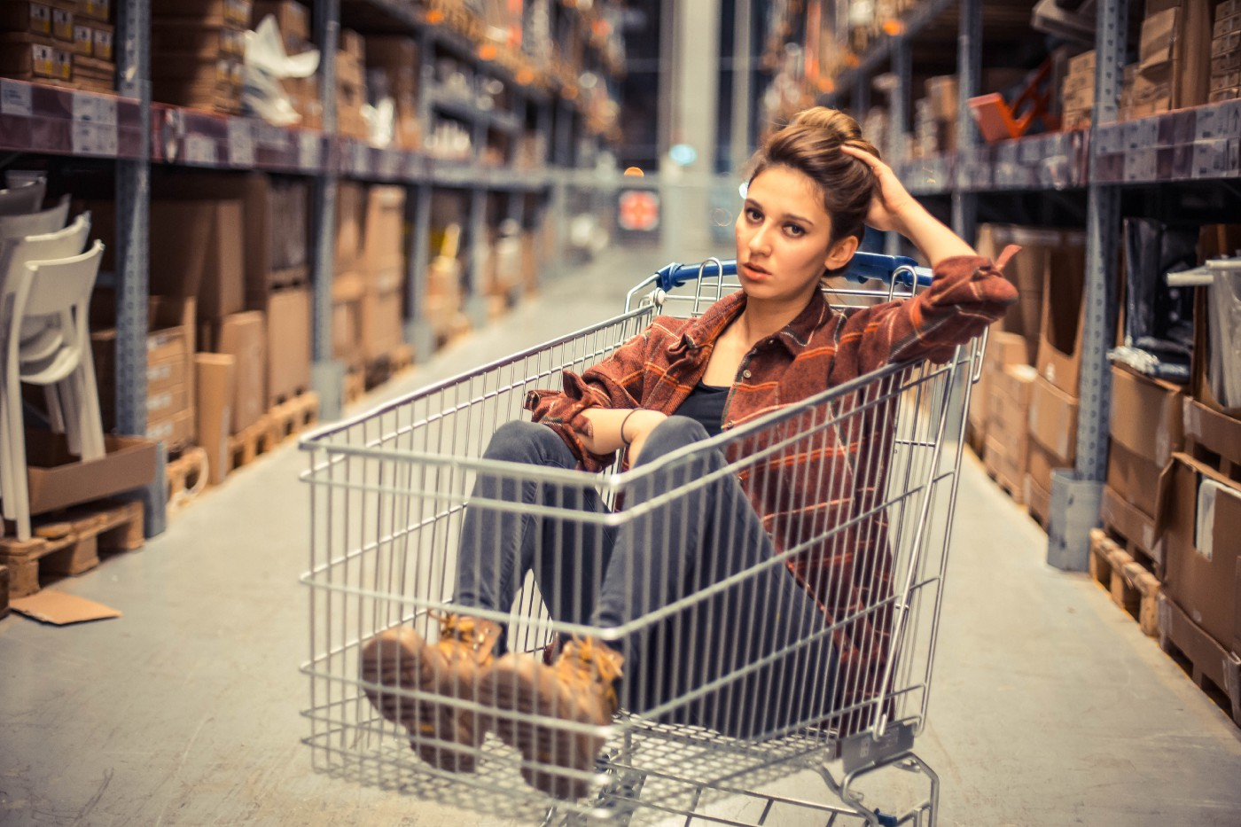 Woman sitting in a shopping cart
