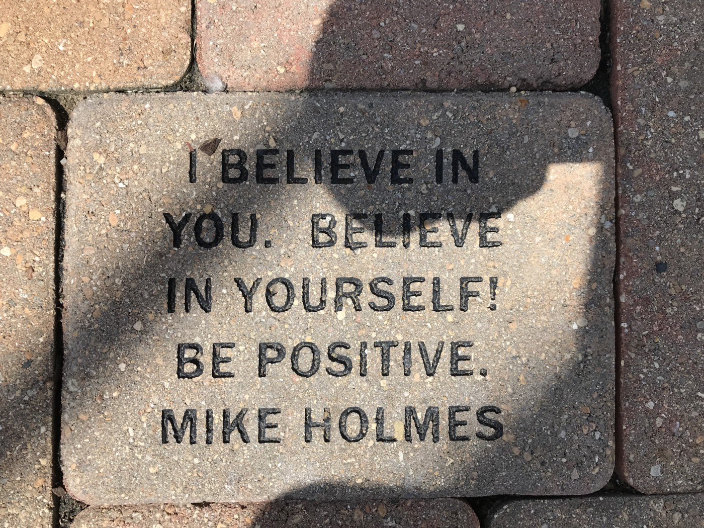 """A square block that says """"I believe in you. Believe in yourself. Be positive. Mike Holmes"""