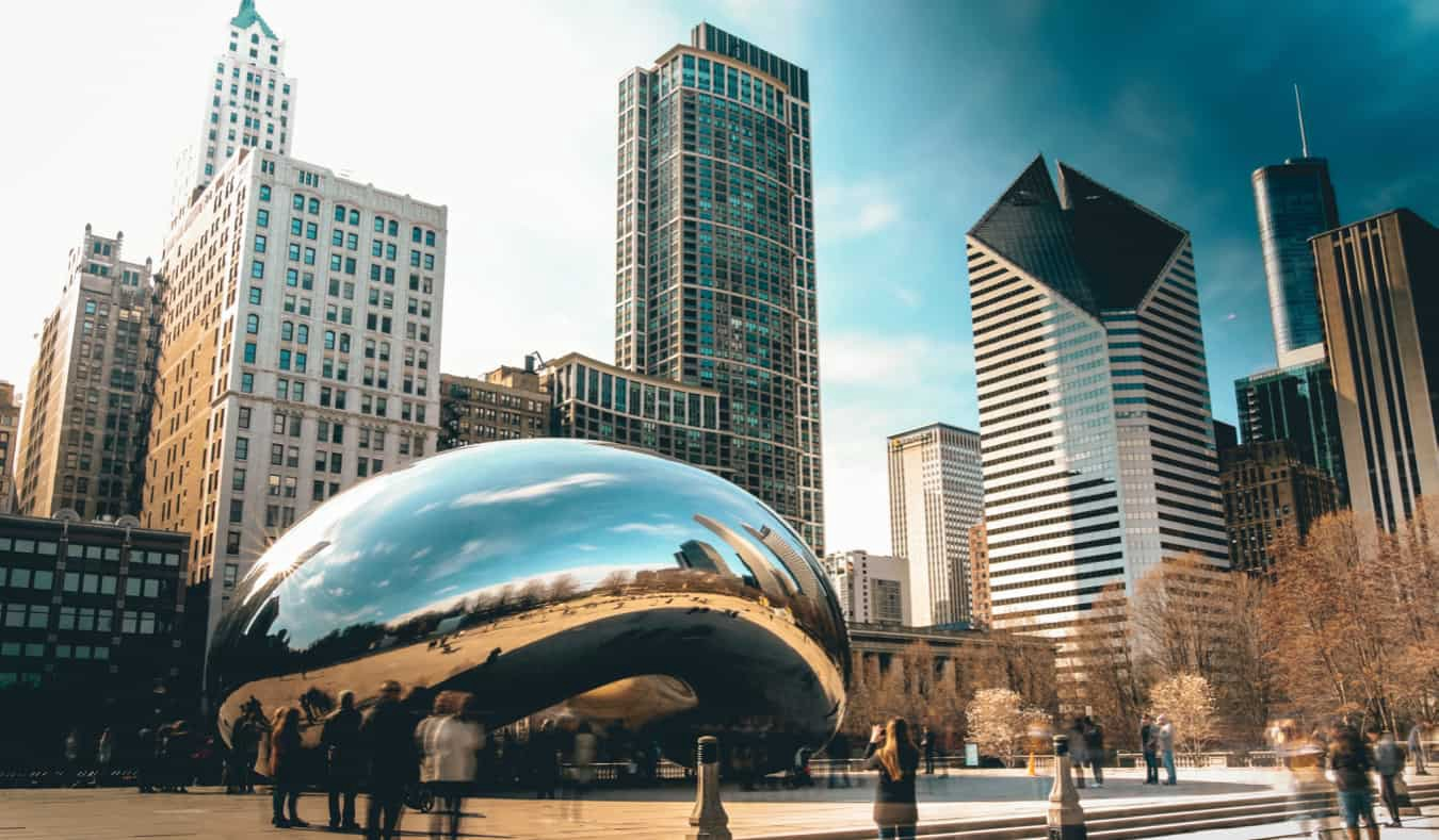 A long-exposure shot of the famous silver bean in Chicago surrounded by people