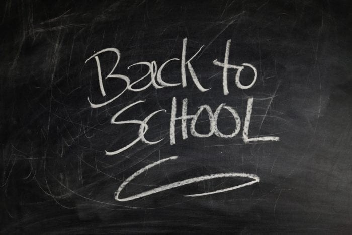 """Chalkboard with the words """"Back to School"""" written in white chalk."""