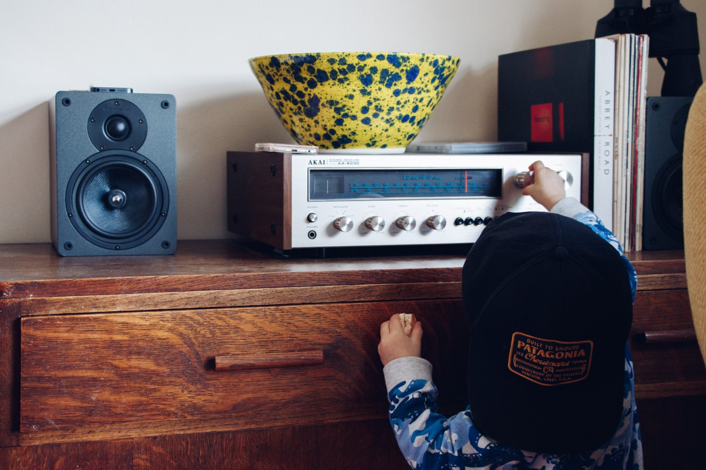 Child playing with dial on stereo