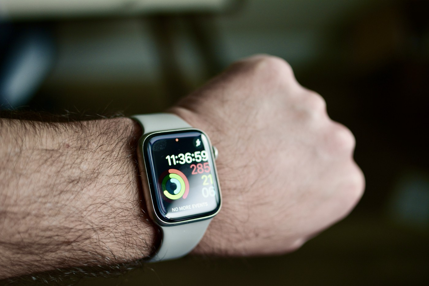 Apple Watch Series 5 on wrist showing the Activty Ring watch face, all rings are not complete.