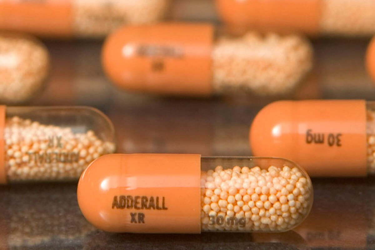 An image showing adderall pills sitting on a table.