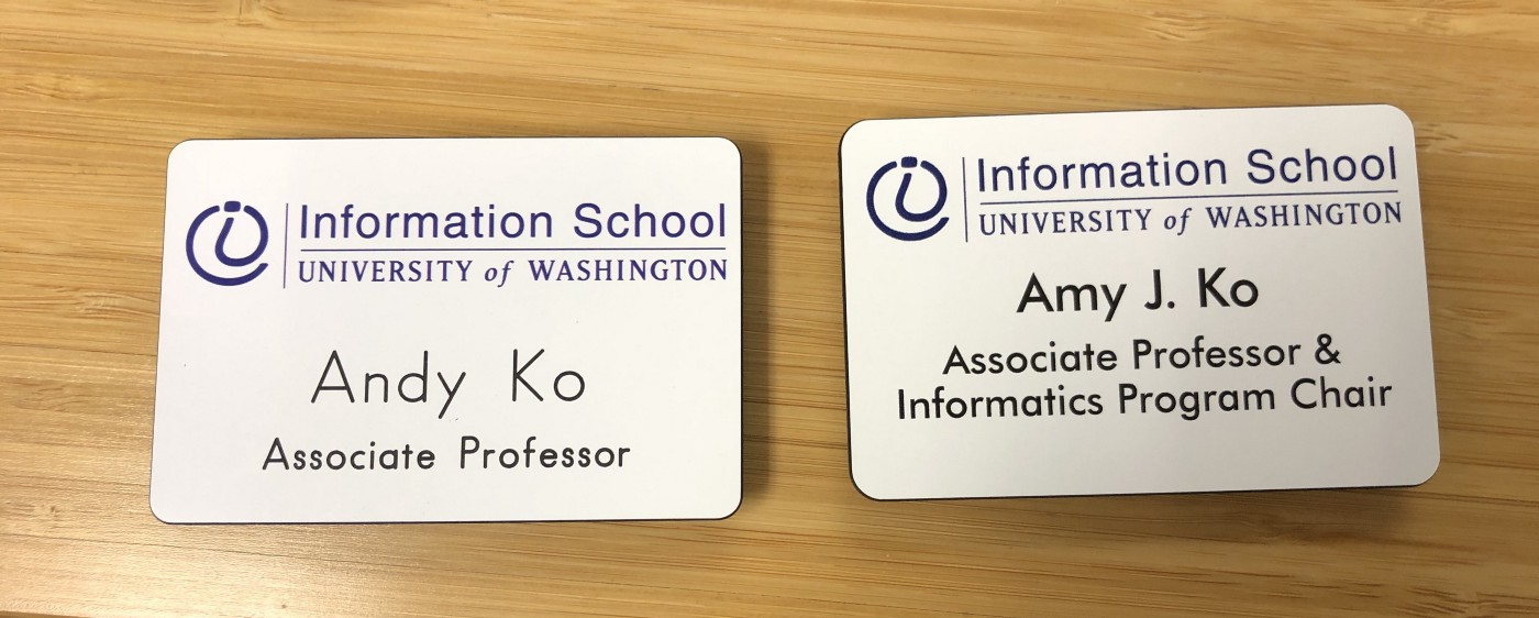 A photograph of before and after UW iSchool name badges.