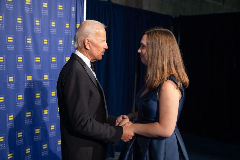 Joe Biden holding the hands of Sarah McBride.