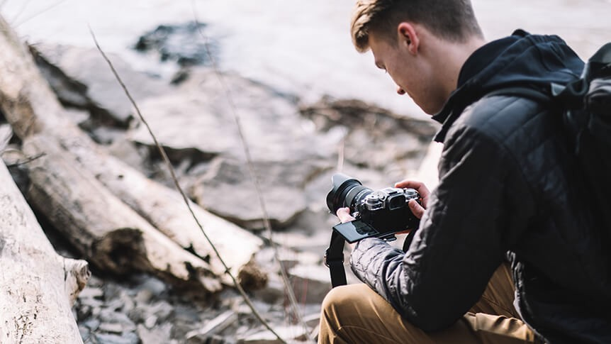 Young man recording video with a FUJIFILM camera