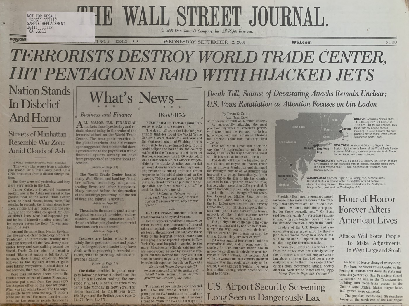 """A photo of the front page of the Wall Street Journal from September 12, 2001 """"Terrorists Destroy World Trace Center—Hit Pentagon in Raid with Hijacked Jets."""""""