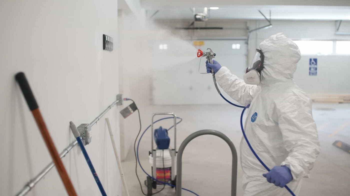 cleaning and disinfecting the office space
