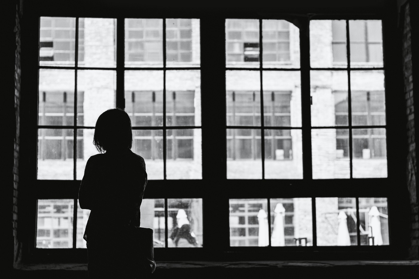 Black and white window with a person in silhouette.