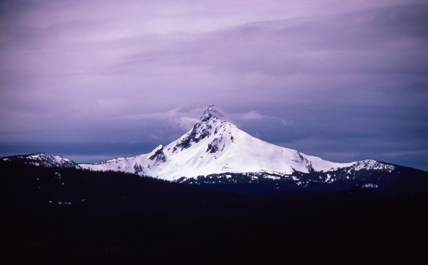 Stock image of a purple snow-capped mountain