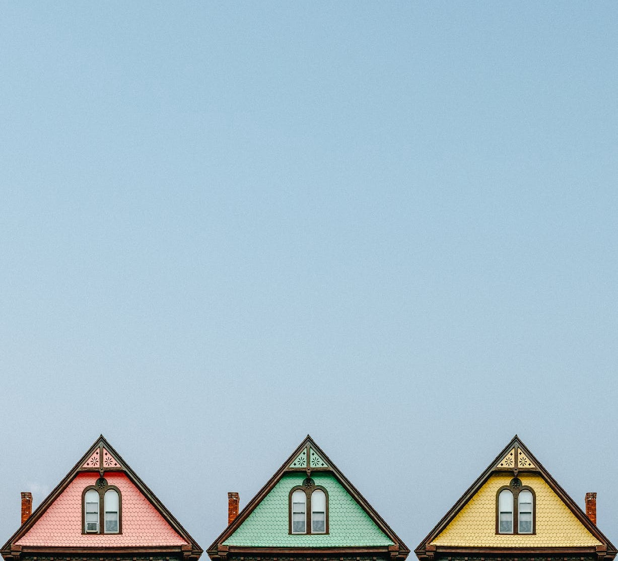 A simple picture of three cropped rooftops next to each other, very close together. Like painted ladies in San Francisco.