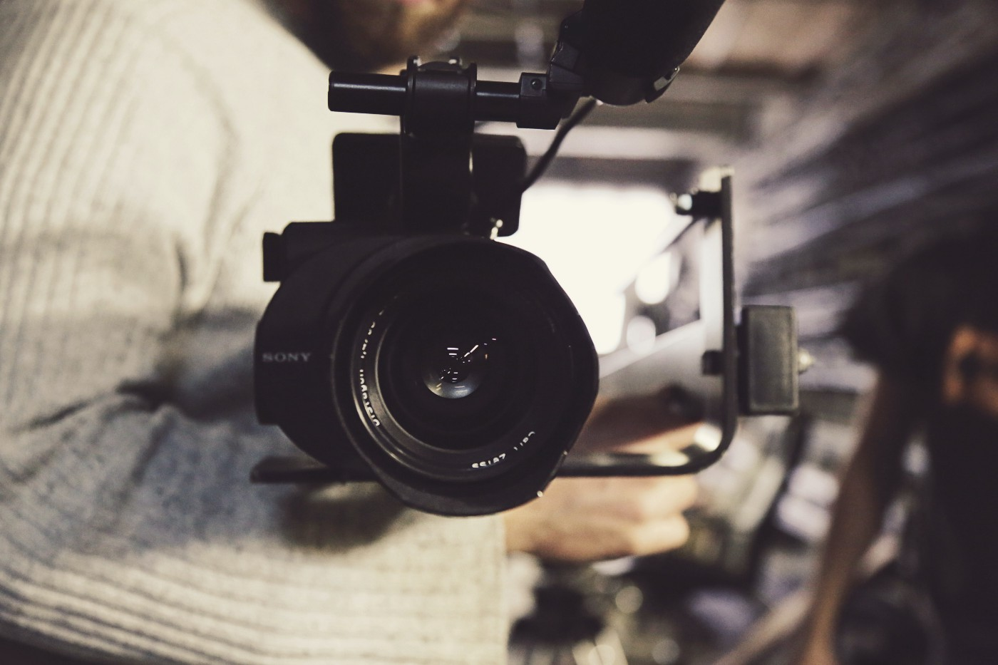 Camera lens photography behind the scenes footage on a shoot with team from Food Story Media digital media agency.