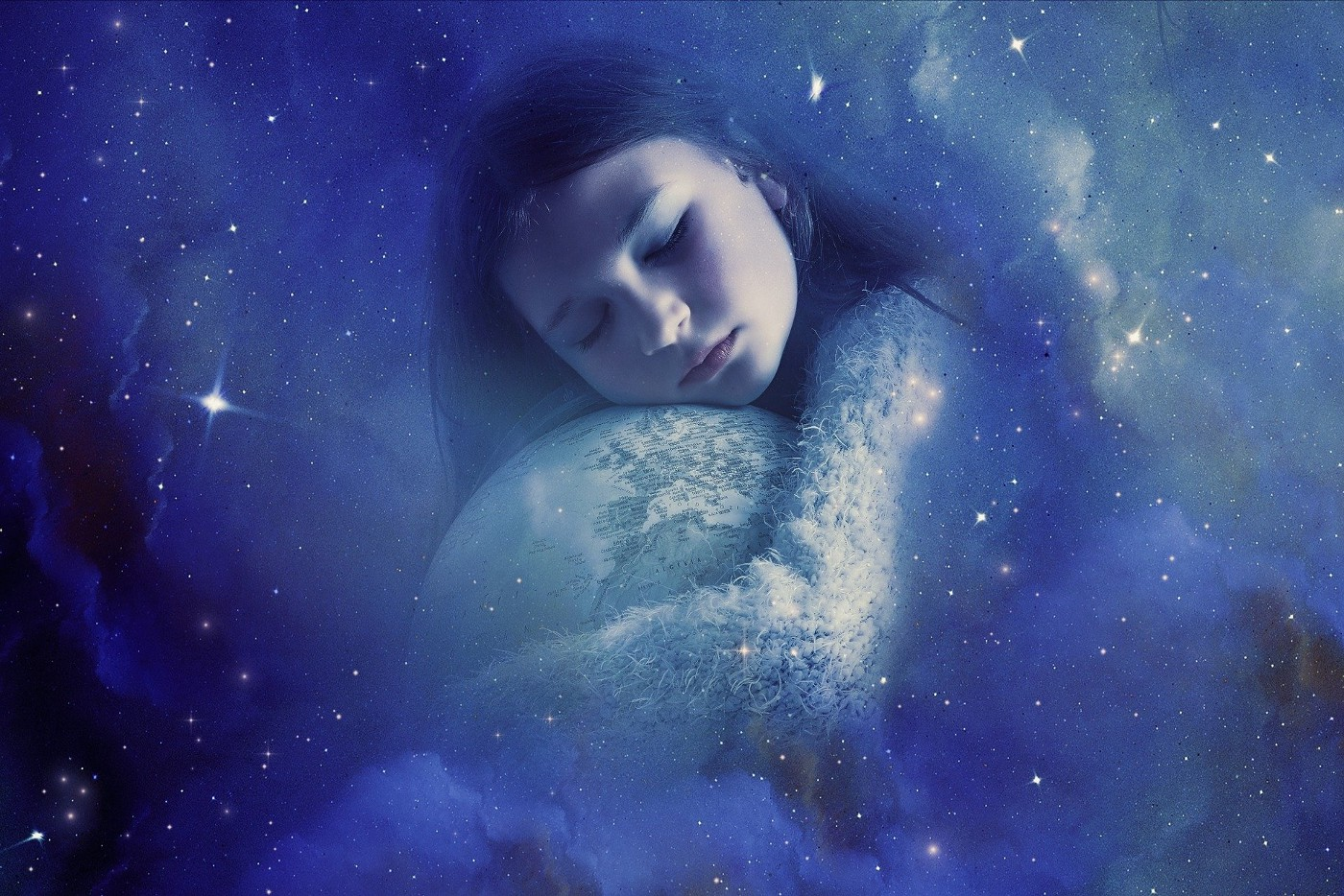 A child with eyes closed, hugging the earth. The picture is in a hazy blue color.
