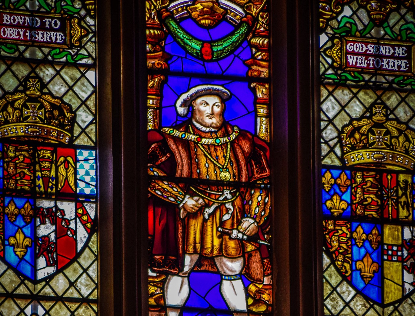Image of Henry VIII pictured on a church, stain glass window.