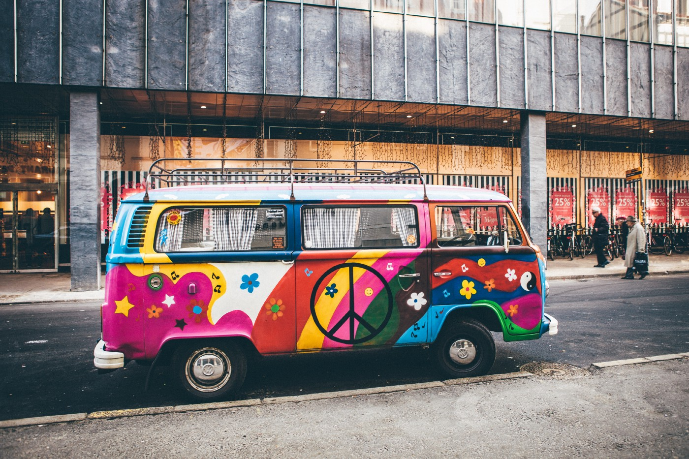 A colorful van with a peace symbol