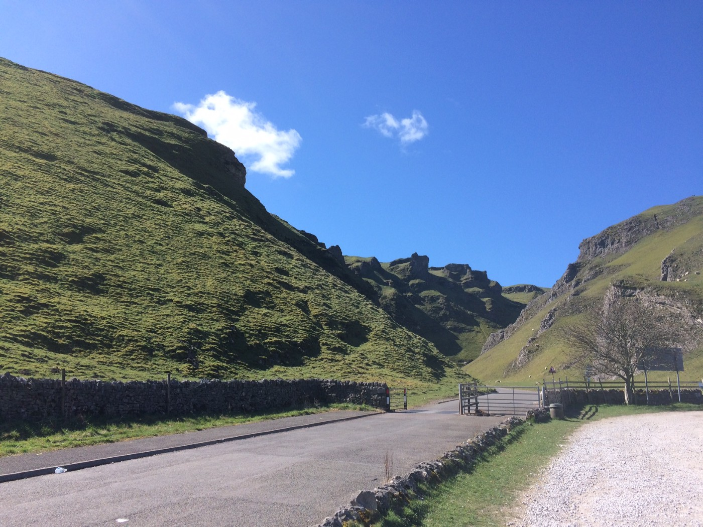 A landscape picture of the limestone gorge Winnats Pass in Derbyshire