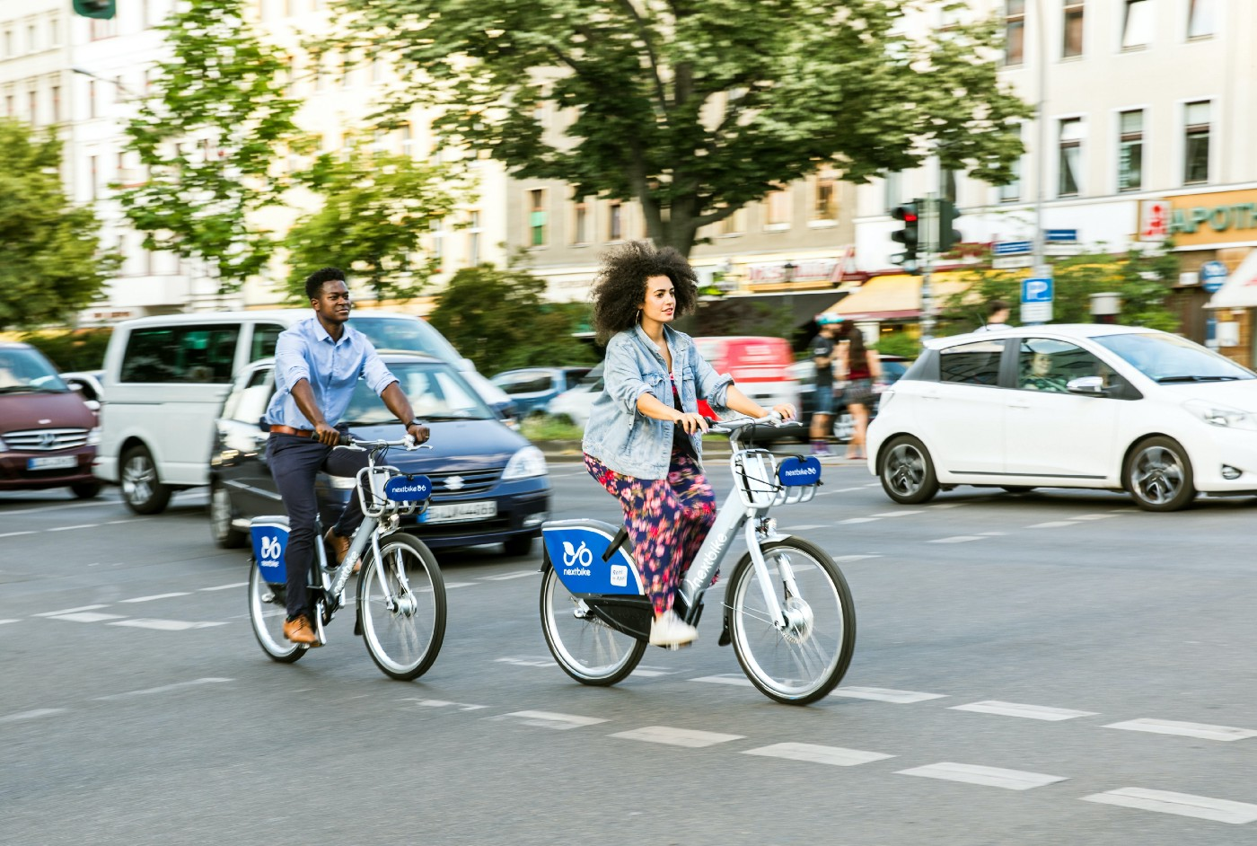 Woman riding a share bike in a city.