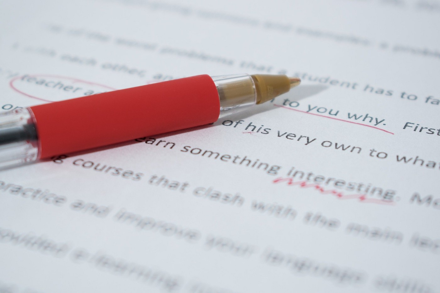A pen on a manuscript being edited.