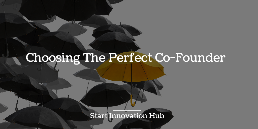A yellow umbrella standing out from a collection of black umbrellas. Text: Choosing the perfect Co-Founder.