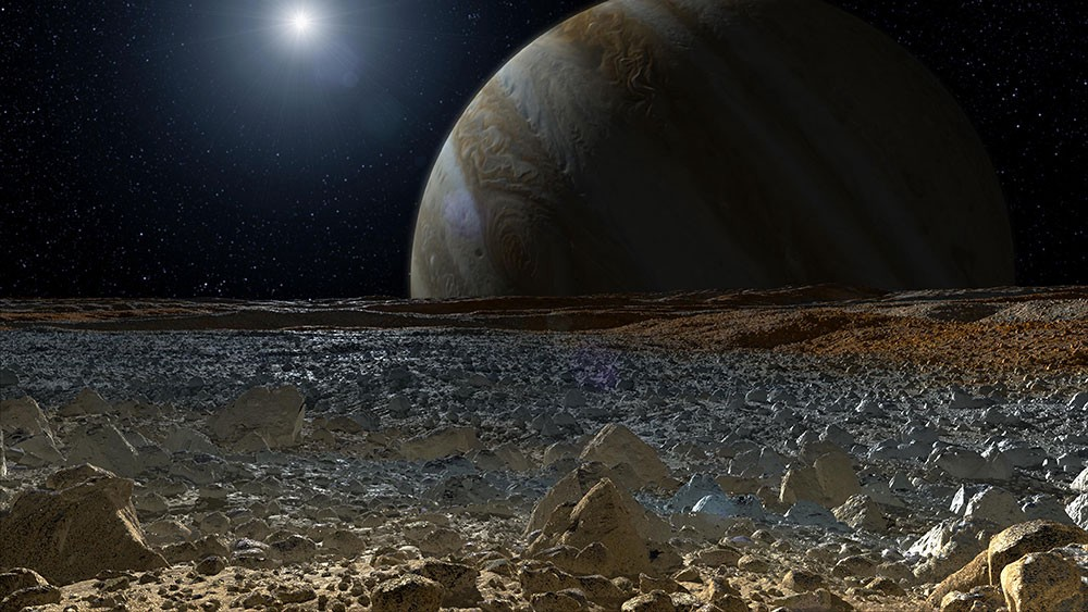 An artist's conception of Europa, with spiky rocks and Jupiter rising over the horizon.