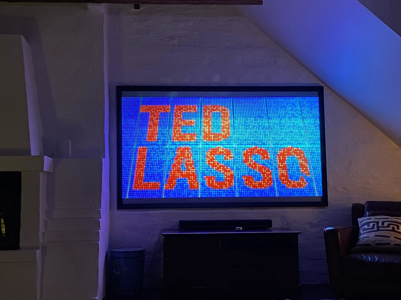 """A photo of a TV screen showing the """"Ted Lasso"""" title card"""