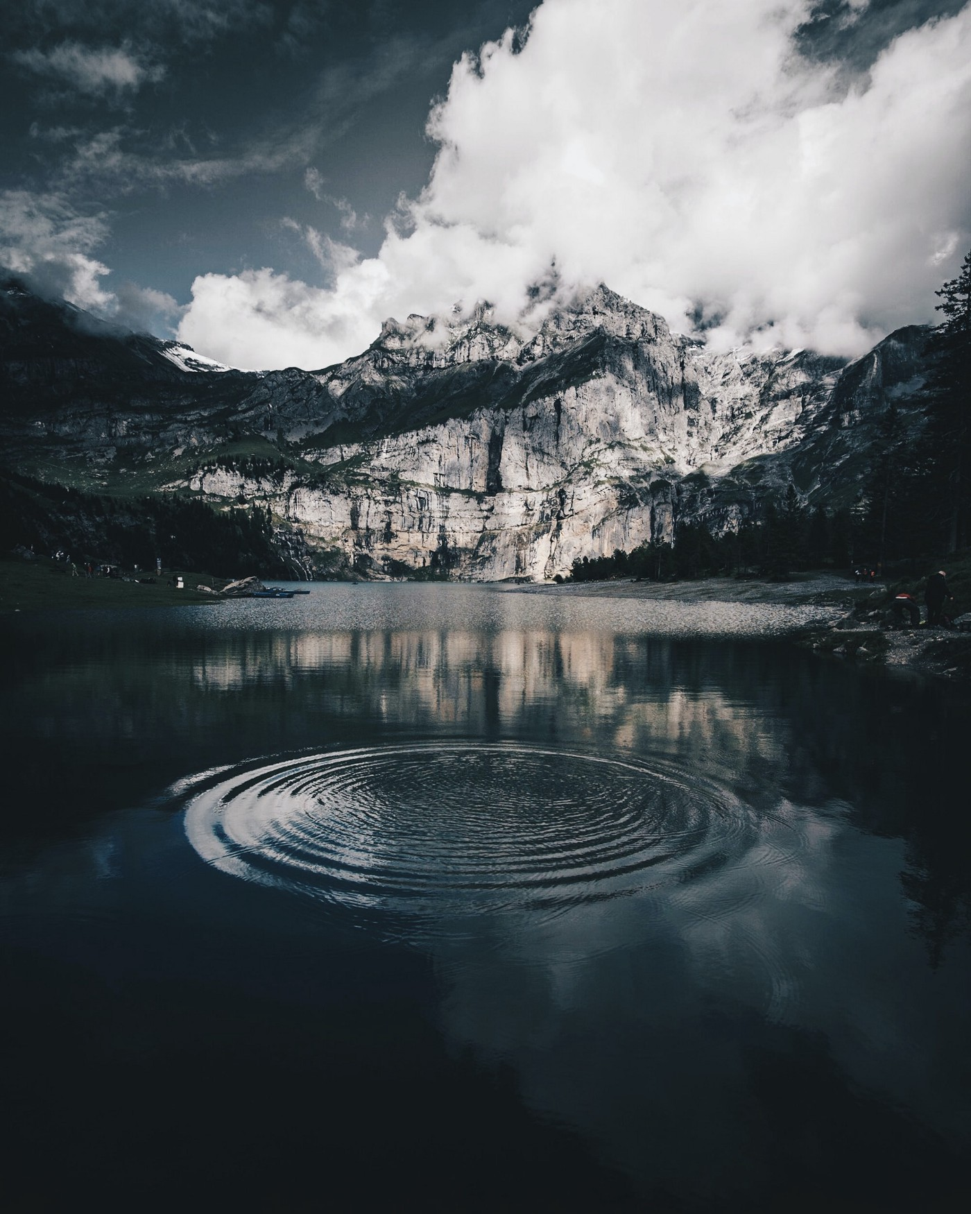 Ripple in a pond on a lake in front of a mountain