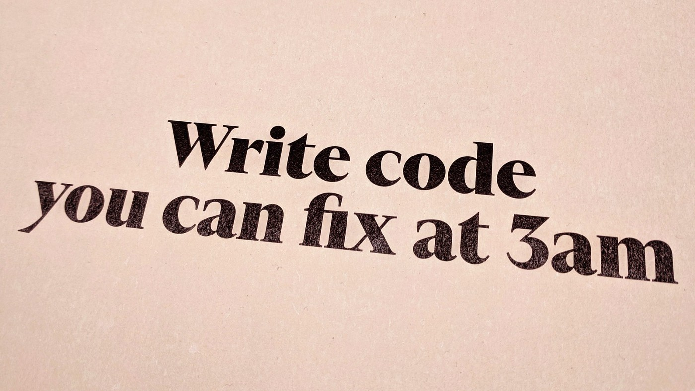 """A printout with the text """"Write code you can fix at 3am"""""""