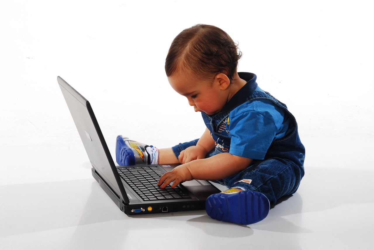 A baby on a computer