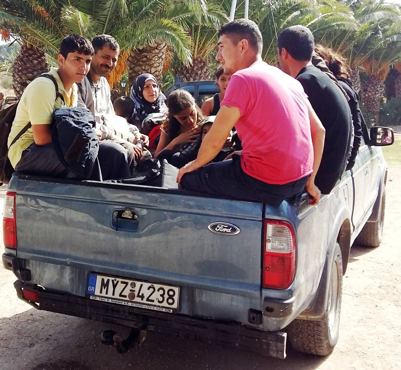 A family loads into the back of a truck at Aphrodite's hotel.