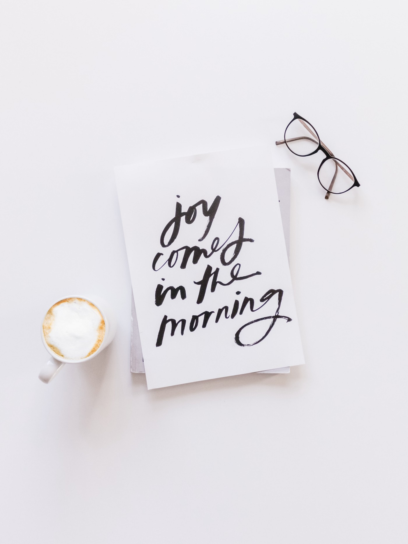Joy comes in the morning calligraphy Photo by Nicole Honeywill on Unsplash