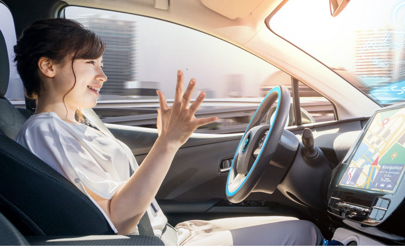 Woman hands off the steering wheel. Eyes on the road monitoring the vehicle