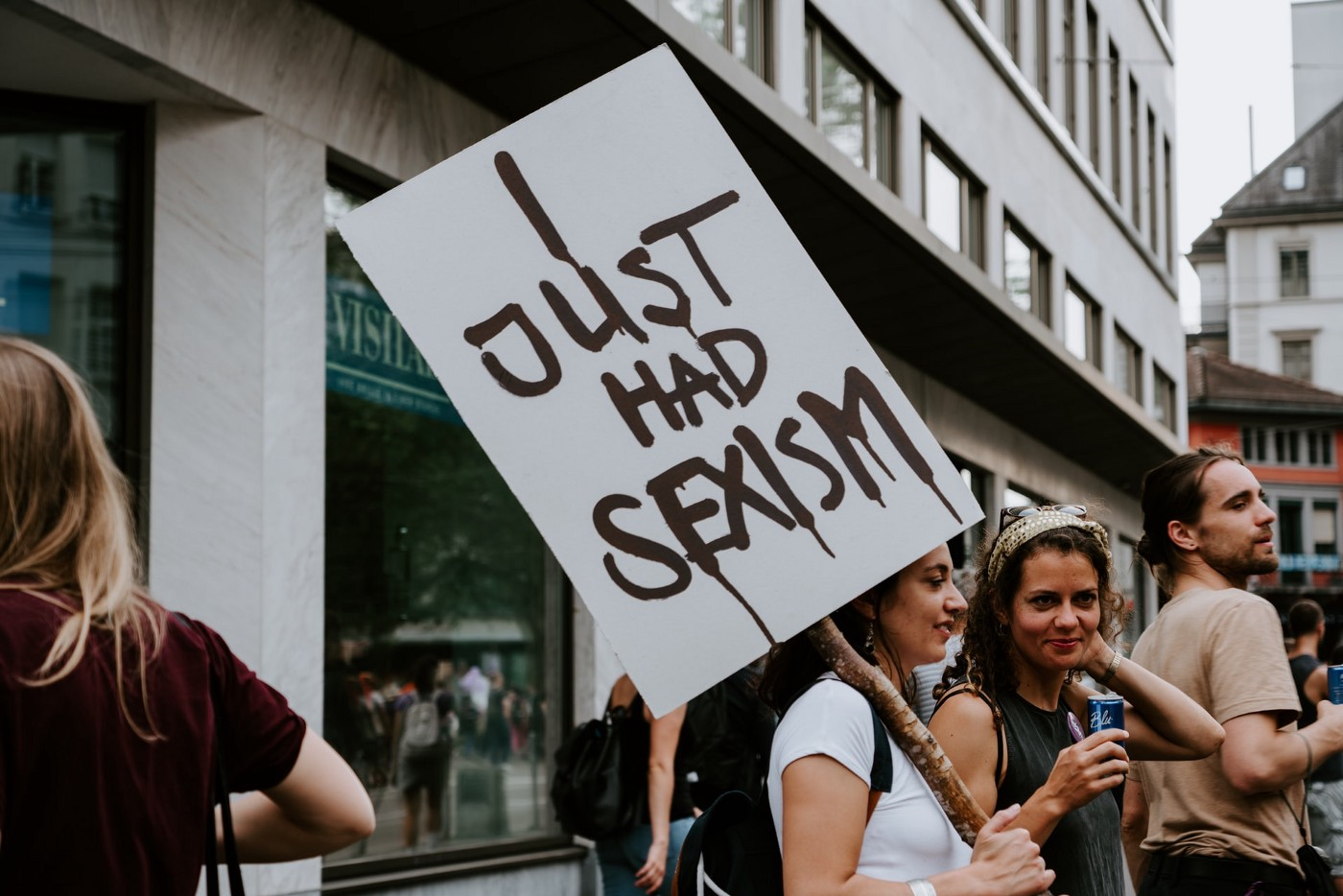 "Women holding a sign that says ""I just had sexism"""