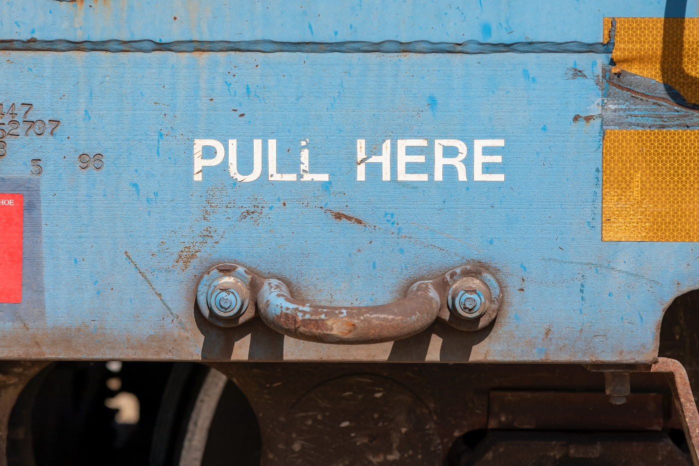 """""""Pull here"""" written above a handle"""