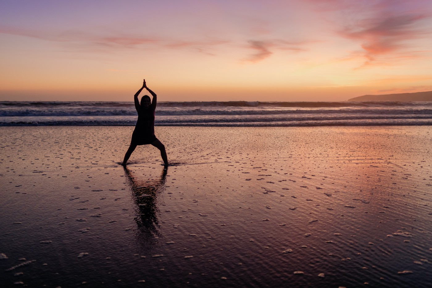 Sunset on the beach. Doing a Yoga and meditation pose