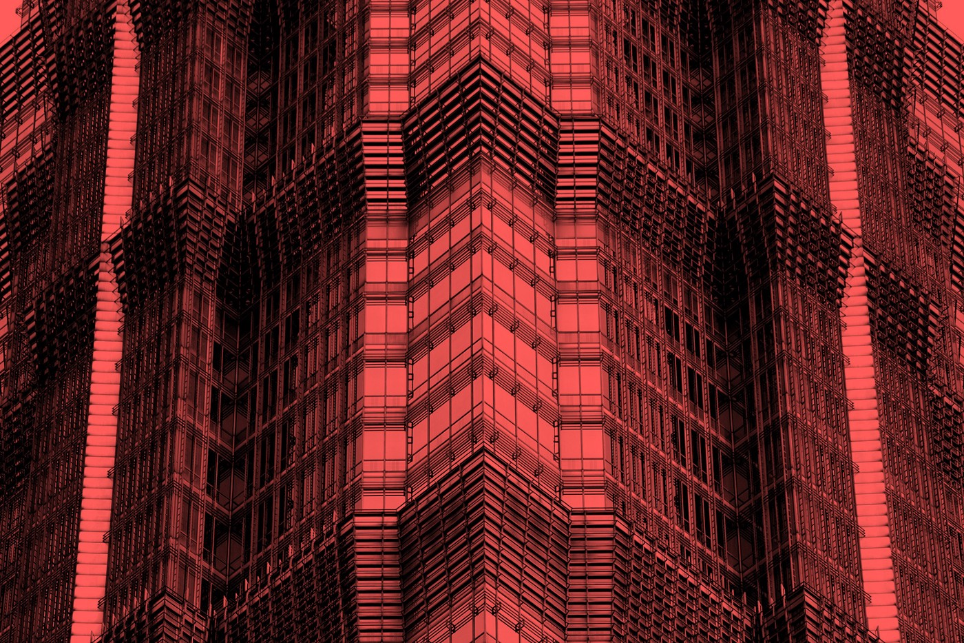 Close up of a geometric skyscraper's corner overlaid with a red filter.