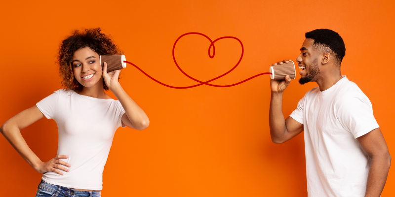 Man and woman talking through cups and string—5 Surprising Reasons To Talk About Your Partner's Past Relationships