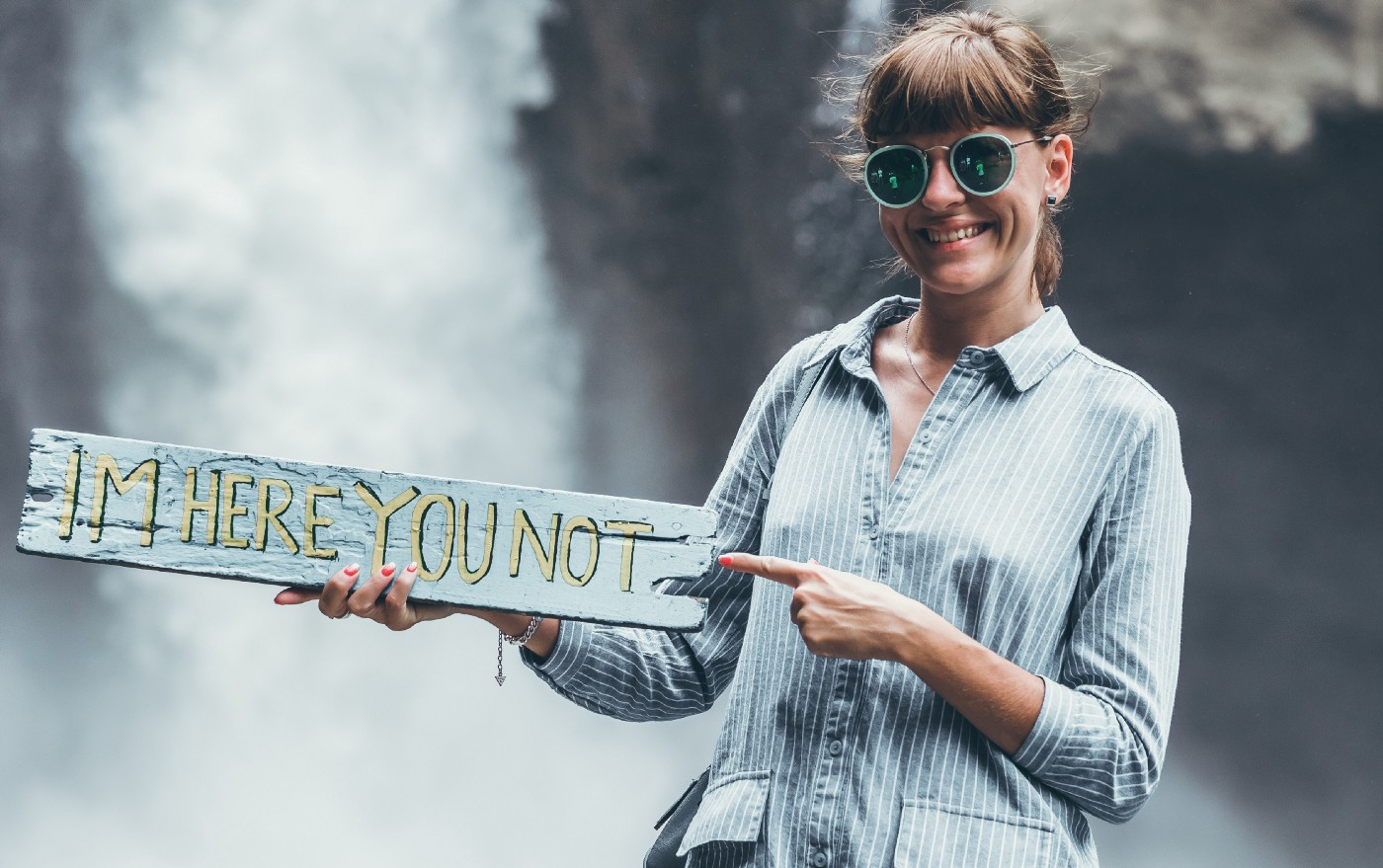 """Girl with glasses and a sign that says """"I am here you not."""" You Can Do the Same, but You Choose Not, Live with It Don't envy others' success paths Instead, love yours"""