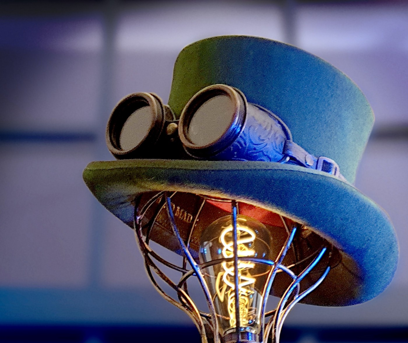 Steampunk hat and goggles sit atop a wiry lightbulb