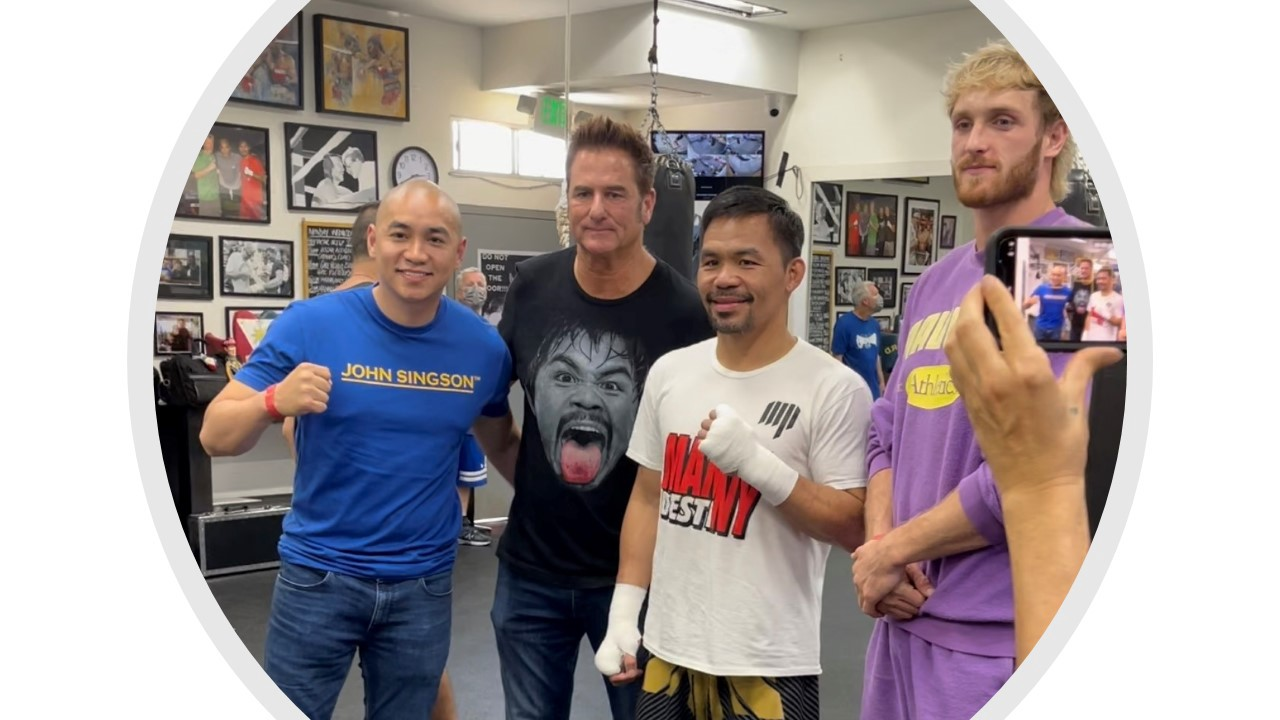 Logan Paul with John Singson, Manny Paquiao, and Sean Gibbons at Wild Card gym.
