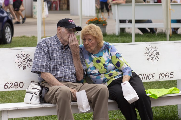 An image of an elderly couple sitting on a bench.