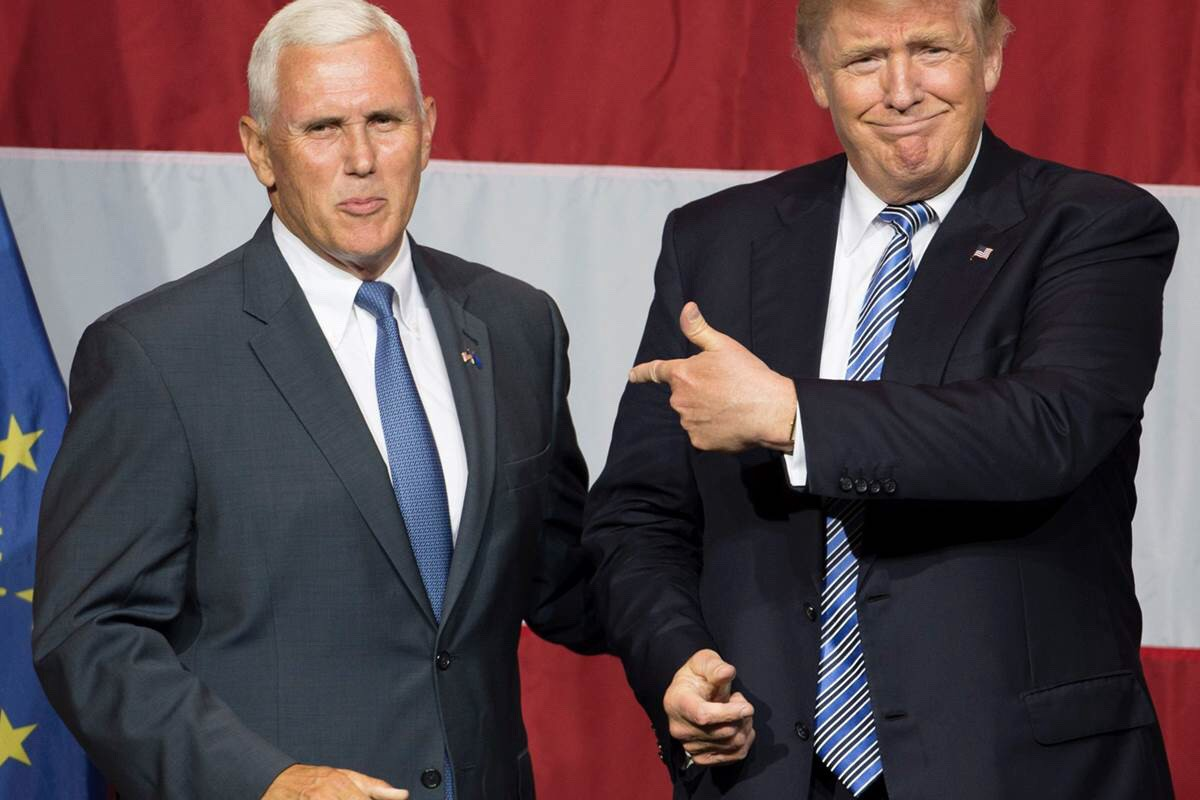 A photo of Donald Trump and Mike Pence in front of an American Flag — Photo Credits: NBC News